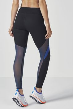 Increase your airflow with a power mesh-paneled performance legging, built with moisture-wicking technology, UPF 50+ fabric and an internal pocket for your cards/keys. | Fabletics Breann Legging II