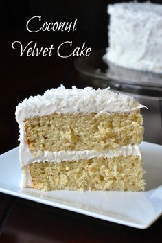 Coconut Velvet Cake - A beautifully moist and tender crumbed cake, flavoured with coconut milk and extract, then covered in a coconut marshmallow frosting and covered in a generous garnish of dried coconut.