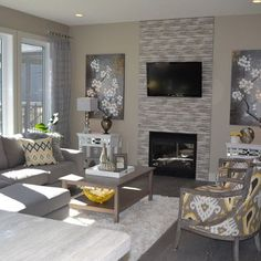 The grey tile fireplace and pops of yellow are right on trend in this living room