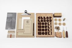 Logo and crafted wooden stationery designed by Sciencewerk for Cheap Labor Brand Identity Design, Corporate Design, Branding Design, Branding Ideas, Identity Branding, Corporate Identity, Logo Design, Brand Packaging, Packaging Design