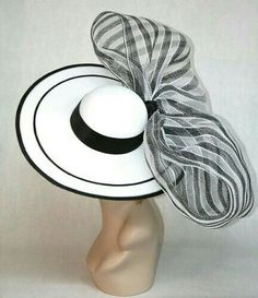 black & white brimmed had with X-tra large bow