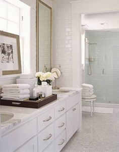 Like this- the floor and the walls all subway tile. Might be cute in Madeline's bathroom or basement.