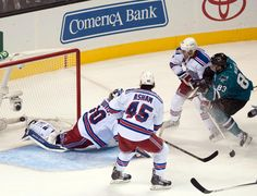 San Jose Sharks rookie forward Matt Nieto beats New York Rangers goaltender Henrik Lundqvist in the second period for his first career NHL goal (Oct. 8, 2013).