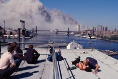 As the twin towers fell, photographer Robert Clark captured an unforgettable portrait of neighbors watching and comforting one another. Twin Towers Falling, 11 September 2001, 911 Memorial, World Trade Center, Trade Centre, Lest We Forget, Back In The Day, National Geographic, American History