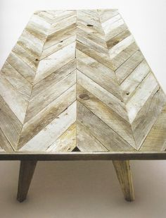Chevron Table Top! Loooove. Another nod to the military using the chevron pattern by using reclaimed wood.