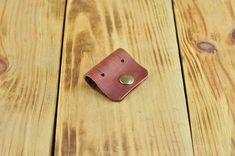 Leather holder for any wires, headphones, chargers, usb cables, adapters Leather cord holder is a necessary accessory for any music lover. This handmade item is created with a great dedication and attention to every detail. Its made of high-quality vegetable-tanned leather and reliable