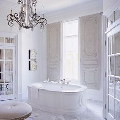 A French bathroom … Wow! Now that's a bathroom! I love the chandelier.