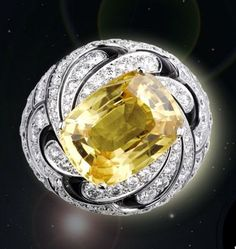 Rosamaria G Frangini   High Yellow Jewellery   Carrie Solar Ring, in white gold, one 12.40-carat cushion-shaped yellow sapphire, black lacquer, brilliant-cut diamonds.