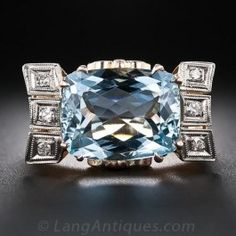 Retro Aquamarine and Diamond Vintage Cocktail Ring - A refreshing swimming pool-blue faceted cushion-cut aquamarine glistens horizontally between diamond-topped ribbons in this ornately detailed cocktail (just-for-fun) ring rendered in gleaming 18 karat rose gold. A uniquely beautiful Retro bauble - circa 1940s.