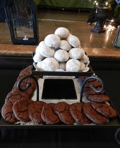 The cookie assembly: Mexican wedding cookies with Mexican hot-chocolate cookies. Made with the finest cocoa, Mexican vanilla, cinnamon, and chipotle.