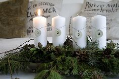 White candle Advent Christmas Decoration - love the layered green base! Comes with awesome tutorial.