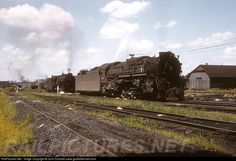 PRR 6490 Pennsylvania Railroad PRR Class J1a, 2-10-4. at Columbus, Ohio by John Dziobko. A PRR Texas-type is being doubled to another PRR brute, probably for the purpose of dragging another coal load north to the docks at Sandusky. Doubleheaded steam was fairly common practice on these runs, the grade getting out of town required it.