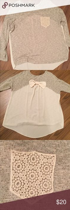Plus Sized Light Knit/Shear Top This top is awesome with its comfy feel to its shear back with a cute bow🎀 to top it off. The pocket on the front is a very pretty lace. Girly is written all over it. 🌷🌺 Moa Moa Tops Tunics