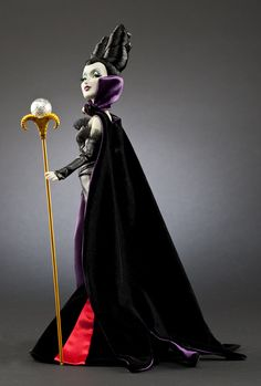 How sad is it that I totally need this doll - she is my favorite villain!    Now Available: Maleficent Disney Villains Designer Collection Doll
