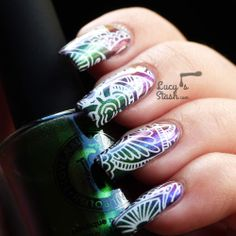 White Mehndi Stamping Nail Art Over Multichrome Gradient http://lucysstash.com/2013/11/white-mehndi-stamping-nail-art-over-multichrome-gradient.html