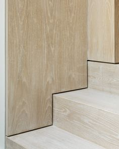 a highly precision installation of a shadow line on the staircase meeting wall panels