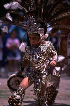 Native American Culture? I think maybe Aztec... Not sure, but he's a cutie in his little outfit.