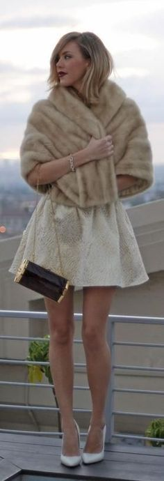 White embossed skater skirt, fur poncho and white heels for winter parties.