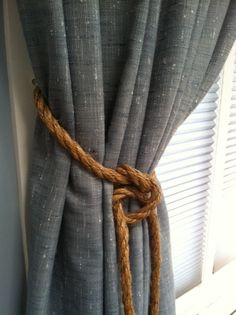 grey curtain rope: living room. finally a use for that rope