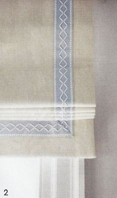 Beautiful roman shades in Kravet 32344-111 Dublin-Cream trimmed in Samuel and Sons in Oxford Border in Glacier/Snow