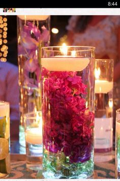 I like the idea of a bougainvillea centerpiece for a Florida wedding. Bringing a bit of the native indoors.