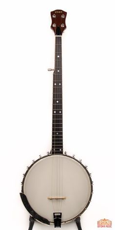 """A fine Martin-era Vega FW-5, """"Folk Wonder"""" from the original owner; featuring a dark stained multi-ply rim, and two piece neck. Simple rolled tonering; equipped with original geared tuners, friction fifth, tailpiece"""