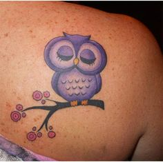 purplr owl tattoo on shoulder