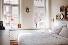A small white bedroom with plenty of storage space