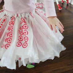 Using the same knotting method as you would make a No Sew Tulle Tutu  you can also make tutu's out of plastic bags. It was SO quick and easy...