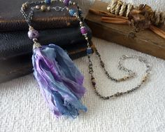 Just Look at the Amazing Blends or Color on this Boho Blue Sari Silk Long Tassel Necklace by ArtandJewelryLove.com Etsy  Discount code available on the site!!!  Trending Pantone Colors Airy Blue and Riverside.  Both  in this Elegant Bohemian Beaded Necklace.  The Naturally Bohemian Collection on etsy Gift Boxed Ready to Ship. artandjewelrylove.com Limited Quantities.