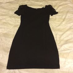 H&M Black Dress Stretchy Black Dress with Lace on the shoulders, lightly* worn, just like new. It is a size small, but does run a little big, and would fit for medium as well. Enjoy! :) H&M Dresses