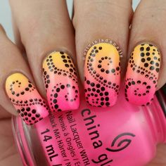 Neon and stamped black dots over a pink and yellow gradient by @oliviajadenails.