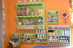 Paint and craft storage from thrift store spice racks and shelves.  Love.