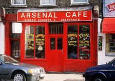 Different eras come and go in football, but some sights remain familiar. Arsenal cafe near the clubs old Highbury home in the 1980s.