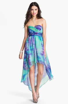 Mixing greens and purples in this high-low dress will make your gorgeous hair pop! via StyleList