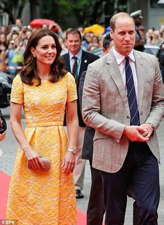 Prince William also went for a more summery look, ditching his usual dark suits in favour of a grey checked blazer