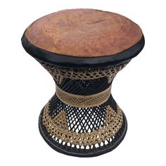 Vintage rattan stool with cushioned leather seat. Made with Black and Tan woven reeds in an hour glass shape. Stool has impression of two elephants on top. The cushion seats show the signs of age with warn and cracking leather. Rattan Stool, Ottoman Footstool, Seat Cushions, Elephants, Nepal, Wicker, India, Signs, Glass