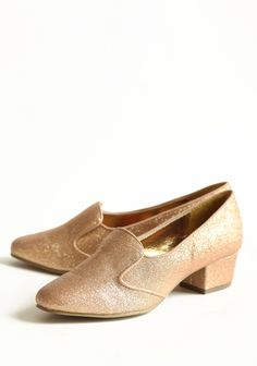 Glittering Noel Indie Heeled Loafers 58.99 at shopruche.com. Finished with a chic pointed toe, these camel flats feature metallic gold-toned striped detailing for a simple touch of shimmer. Pair these faux suede flats with tights or wear them alone all year round. Indie made by B.A.I.T....