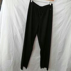 Nike Dri . Fit Black Pants The pants have a drawstring waist, are a 100% polyester.  Size: L ( 12- 14) Nike Pants Track Pants & Joggers