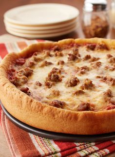 This deep dish is the real deal. Click through to learn how to make authentic Chicago-style pizza at home.