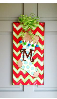 Canvas painting with acrylic.  Glued on balls & wooden letter.