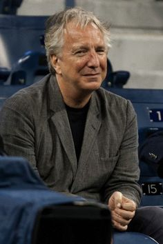 Alan Rickman watches the men's singles quarterfinal match on Day Ten of the 2012 US Open at USTA Billie Jean King National Tennis Center on September 2012 in the Flushing neighborhood of the Queens borough of New York City. September 2012