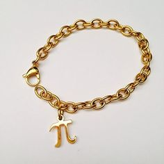 Amythyst Yellow Gold Tone Cable / Round Rolo Link Ankle Bracelet with Pi Symbol Pendant / Charm (11.5 Inches). Hypoallergenic, nickel and lead free stainless steel. Simple yellow tone round rolo link bracelet with a pi sign pendant. Ankle bracelet measures approx. 11.5 inches long (longer length for thicker ankles). Pi charm measures approx. 15mm x 12mm.