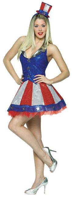 1944 Aunt Samantha Costume - Aunt Samantha Women Costume includes a shimmering sequin halter style dress with a blue and silver top and a fabulous red and white striped skirt. A red, white, and blue star and stripes mini top hat is also included. This patriotic Costume is available in One Size fits most sizes (6-10)