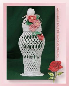 """Delightfully whimsical, our crochet apothecary is easier to work than you might think. Crocheted flowers cascade down the side of the lid and side creating a lovely decor item for any room of the house. Crochet a piece of art and encase your """"keepsakes"""" within.Rated: Int"""