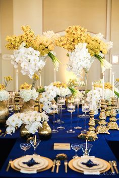 The arrangement WedLuxe – Royal Blue   Photography by: Kunioo Photo Follow @WedLuxe for more wedding inspiration!