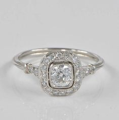 Pure Light! This more than exquisite Art Deco period Diamond target ring is the most charming style either for engagement than for life companion Charming target style, finest hand workmanship, highly detailed and most accurately made of solid PLATINUM - tested ad guaranteed Simple,