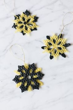 These handmade beeswax ornaments are made from sheets of natural beeswax for a beautiful finished product that will bring rich texture to your tree. Natural Christmas, Winter Christmas, Snow Flakes Diy, Do It Yourself Crafts, Diy Candles, Snowflakes, Snowflake Ornaments, Diy Craft Projects, Homemade Gifts