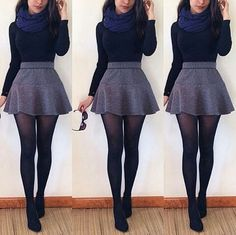 Grey tweed Skirt, Black long sleeve, tights, & booties. Paired with a Navy Blue chunky scarf.