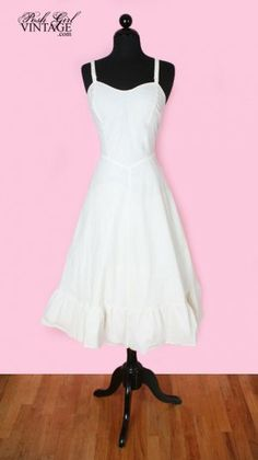 """$199 """"This is a vintage slip dress from the late 40's early 50's. It can be worn as a dress but was originally intended for a slip to wear under your full skirt dresses. Metal side zipper, adjustable straps with metal hardware, unlined , full skirt with ruffle at the bottom. If you look up close the fabric has a subtle tone on tone small repeating design in it. It doesn't show up in the photos. It's too big for our size 3/4 mannequin, we clipped the waist in the front facing photos to show…"""